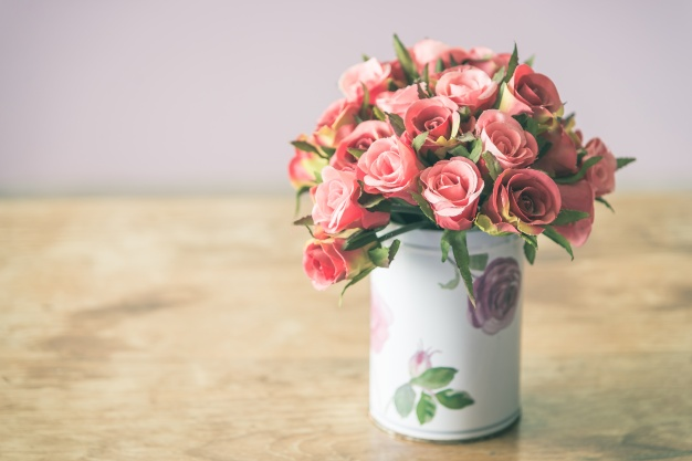 vase-with-decorative-flowers_1203-1640